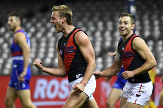 Darcy Parish relishes the moment after scoring.