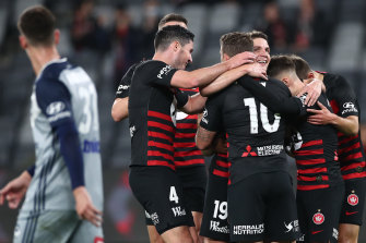 Wanderers players mob retiring midfielder Pirmin Schwegler after he scored in his final game.