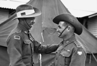 Lieutenants Reginald Saunders and Tom Derrick VC congratulate each other on receiving their commissions in November 1944. The two men shared a tent during their officer training.