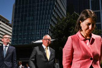 Premier Gladys Berejiklian, Treasurer Dominic Perrottet and Health Minister Brad Hazzard front the media today.