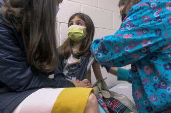 Alejandra Gerardo, 9, gets the first of two Pfizer COVID-19 vaccinations during a clinical trial for children at Duke Health in North Carolina in the United States.