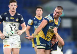 Eels fullback Clint Gutherson gets a deft pass away against the Cowboys on Saturday night.
