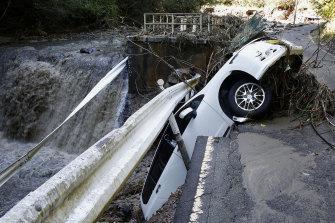 A vehicle falls off collapsed road in the typhoon-hit Kakuda city, Miyagi prefecture, northern Japan on Sunday.