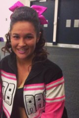 Ms Cini at a cheerleading event in 2014.