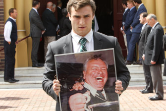 Randwick club captain Nick Wilkinson holds a portriat of Sayle.
