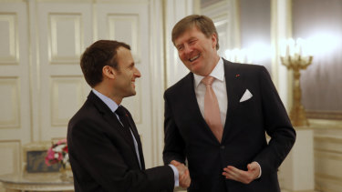 Dutch King Willem-Alexander shakes hands with French President Emmanuel Macron last month.