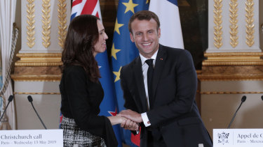 New Zealand Prime Minister Jacinda Ardern, left, and French President Emmanuel Macron shake hands after the Christchurch Call to Action conference in Paris.