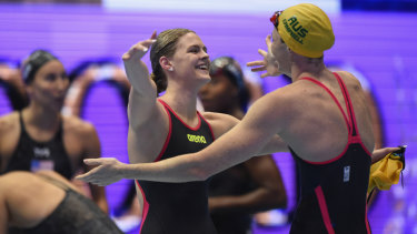 Gold rush: Shayna Jack celebrates victory with Cate Campbell.