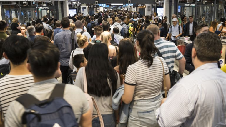 Commuters endure major overcrowding at Sydney's Town Hall station.