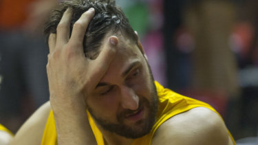 Bad day at the office: Andrew Bogut sweats it out on the Kings bench.