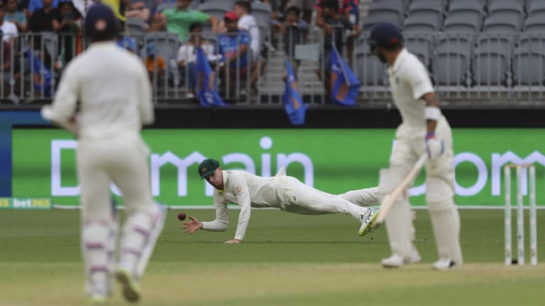 Caught out: Peter Handscomb takes the catch that dismissed Indian master blaster Virat Kohli.