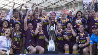 Maiden title: The Broncos celebrate winning the NRLW premiership.