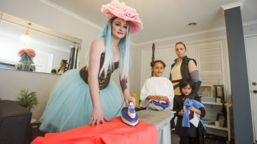 Prepping their costumes: Cosplayers Isabella Hurst, and Sophie, Alysha and Elijah Khokhar.