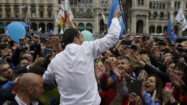 Supporters reach out to touch League leader Matteo Salvini during a rally organised by the nationalist party.