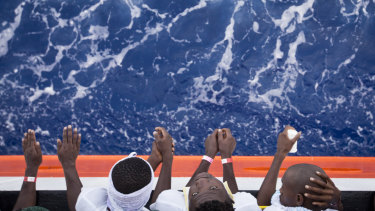 African migrants stand on the deck of the Aquarius in August.