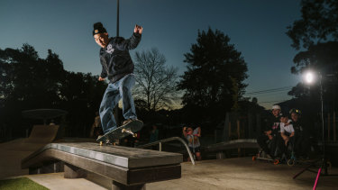 Wei Lee performs a 'front side 5.0' in front of an appreciative crowd at the Meadowbank Skate Park.