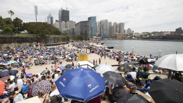 Thousands wait at Circular Quay in preparation for New Year's Eve in Sydney on Monday.