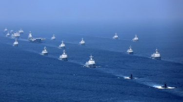 China's Liaoning aircraft carrier is accompanied by navy frigates and submarines conducting exercises in the South China Sea in 2018.