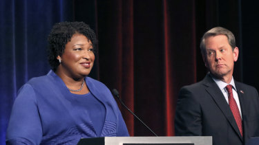 Democratic gubernatorial candidate for Georgia Stacey Abrams, left, speaks as her Republican opponent Secretary of State Brian Kemp looks on during a debate in Atlanta in October.