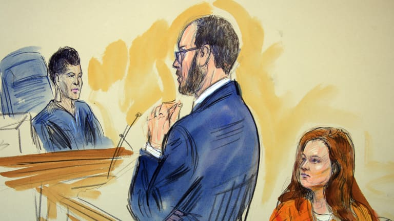 This courtroom sketch depicts Maria Butina, a 29-year-old gun-rights activist suspected of being a covert Russian agent, listening to Assistant U.S. Attorney Erik Kenerson as he speaks to Judge Deborah Robinson, left, during a hearing in federal court.