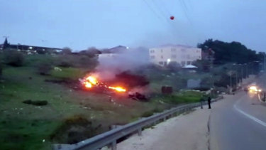 The wreckage of a jet on fire near Harduf, northern Israel.