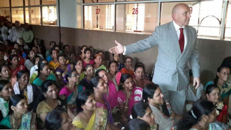 Barrister Niall Coburn addresses victims of the Pearls alleged Ponzi scheme in Pune, India.