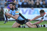 Aaron Woods opens the scoring for the Sharks against the Dragons.