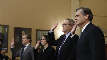 Constitutional law experts, Harvard Law School professor Noah Feldman, Stanford Law School professor Pamela Karlan, University of North Carolina Law School professor Michael Gerhardt and George Washington University Law School professor Jonathan Turley are sworn in before testifying during a hearing before the House Judiciary Committee on the constitutional grounds for the impeachment of President Donald Trump, on Capitol Hill in Washington, Wednesday, Dec. 4, 2019. (AP Photo/Alex Brandon)