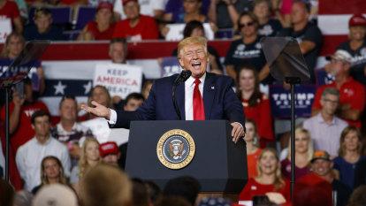 Trump intensifies attack on Democratic congresswomen as crowd chants 'Send her back!'