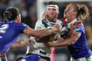 Rounded up: Josh McGuire of the Cowboys is tackled by Tohu Harris, Lachlan Burr and Chanel Harris-Tavita at Mt Smart Stadium.