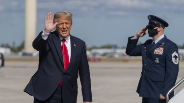 Donald Trump waves to the media after his final flight on Air Force One at Palm Beach International Airport in Florida.