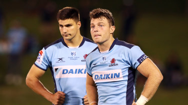 Wallaby Jack Dempsey (right) has been dropped to the Waratahs bench for their match against the Queensland Reds.