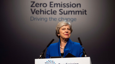 Theresa May delivers a speech at the Zero Emission Vehicle Summit in Birmingham last year.