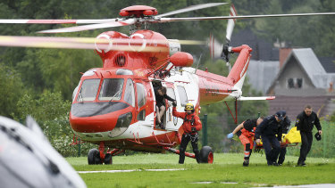A rescue helicopter brings the first patients to hospital after lightning struck the Tatra Mountains.