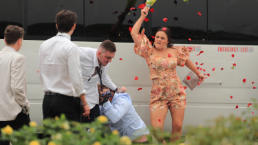 Blooming disgrace: A woman hits two brawlers with a bunch of roses.