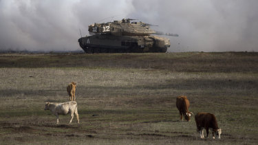 An Israeli Merkava Mark 4 tank drives close to livestock during an exercise in the Israeli-controlled Golan Heights, near the border with Syria. President Donald Trump's move to recognise Israeli sovereignty over the Golan Heights turns the tables on decades of US diplomacy and international law.