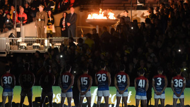 Before the bounce: Melbourne players during the ANZAC pre-game ceremony.