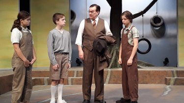 Jade Breen (Scout), Jake Keen (Dill), Michael Sparks (Atticus) and Jamie Boy (Jem) on the set of To Kill a Mockingbird at Theatre 3.
