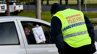 A person wishing to cross the border on Wednesday morning presents documentation at Wodonga.