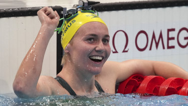 Ariarne Titmus celebrates after mowing down Katie Ledecky to win gold in the 400m freestyle.