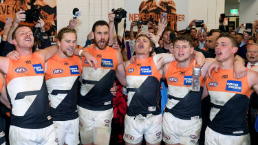 GWS Giants players belt out There's a Big, Big Sound after their win over Collingwood.