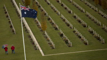 Two visitors walk among the headstones at the World War I Australian National Memorial in Villers-Bretonneux, France.