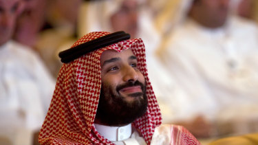 Saudi Crown Prince, Mohammed bin Salman, smiles as he attends the Future Investment Initiative conference.