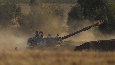 An Israeli artillery unit fires toward targets in Gaza Strip.