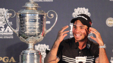 Jason Day celebrates his first major championship, the US PGA, in 2015.