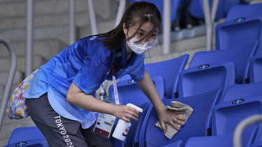 Selfless: A volunteer cleans the seats at the venue hosting tennis in Tokyo, in a typical gesture at these Games.