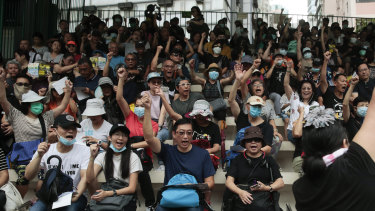Protesters pumped their fists as they chanted slogans in the stands of the soccer field at Southorn Playground in Wan Chai, Hong Kong.