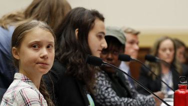Youth climate change activist Greta Thunberg, left, prepares to speak at a House Foreign Affairs Committee subcommittee hearing on climate change in Washington.