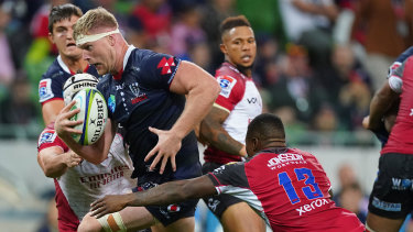 Matt Philip makes some hard metres for the Rebels against the Lions at AAMI Park.