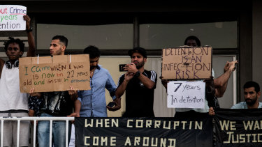 Asylum seekers protest on the balconies of a detention centre in Brisbane.